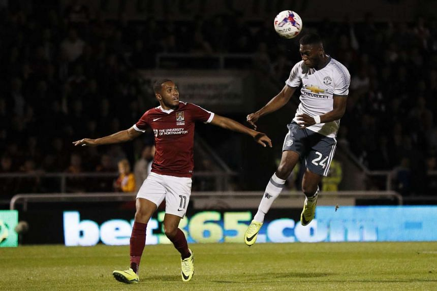 Manchester United's Timothy Fosu-Mensah heads against the crossbar.