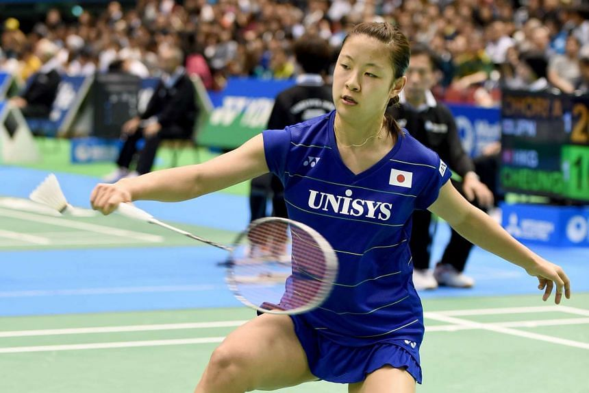 Nozomi Okuhara of Japan returning a shot against Chen Yufei of China during their women's singles second round match at the Japan Open badminton tournament in Tokyo on Sept 22.