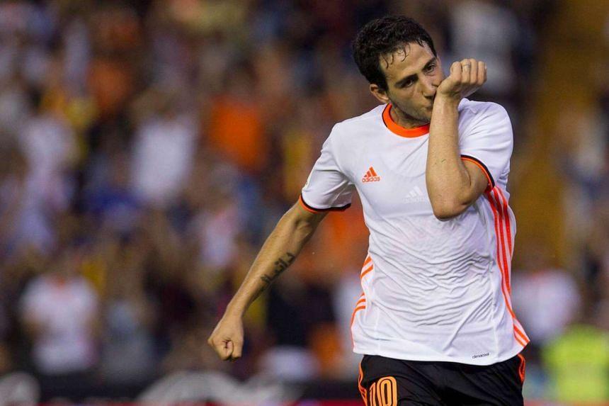 Valencia's midfielder Dani Paerjo celebrates the second goal against Alaves.