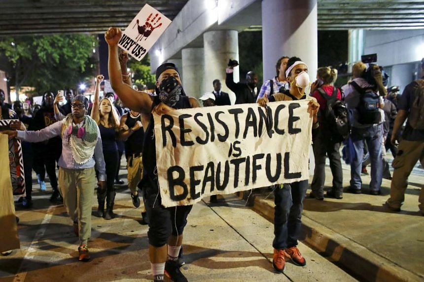 Protesters walk in the streets downtown during another night of protests over the police shooting of Keith Scott in Charlotte, North Carolina, US, on Sept 22, 2016.