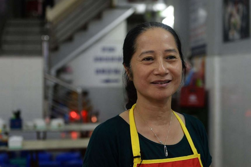 Nguyen Thi Lien, owner of the Bun Cha Huong Lien restaurant, speaking during an interview with AFP inside her restaurant in Hanoi on Sept 12.