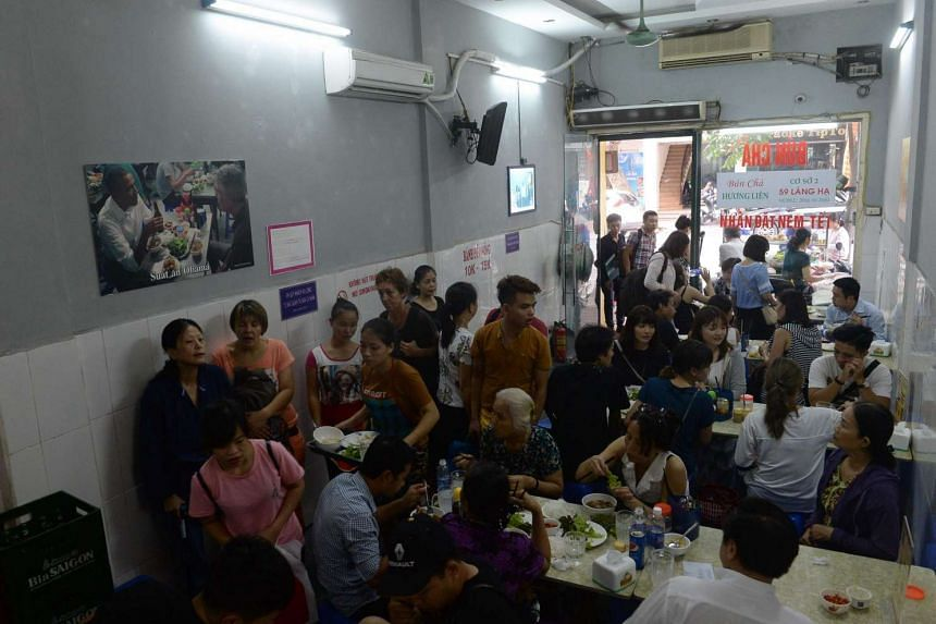 Customers waiting for tables inside the Bun Cha Huong Lien restaurant in Hanoi.