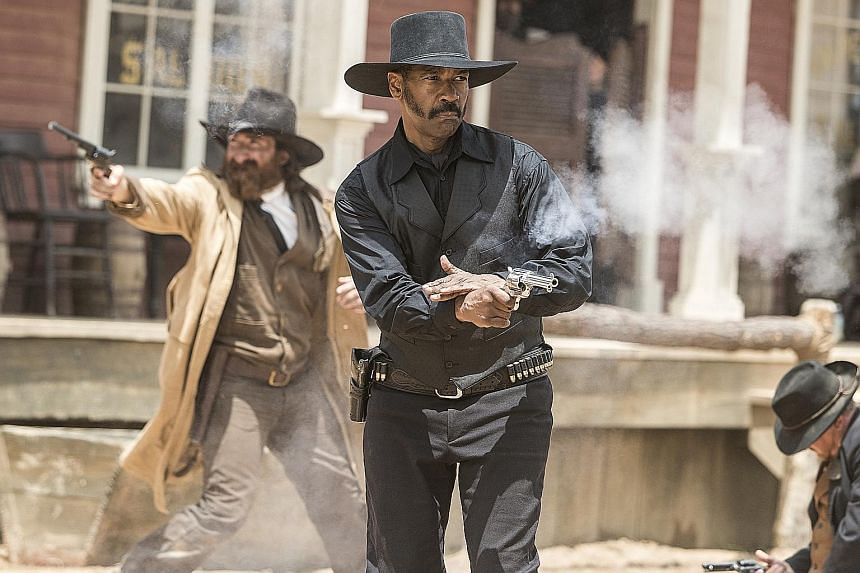 Denzel Washington (left) plays the African- American leader in The Magnificent Seven.
