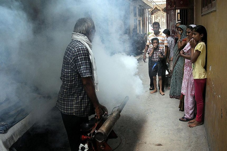 A residential area in New Delhi being fumigated yesterday. The state government and municipal authorities have taken flak for not taking enough precautions to prevent a seasonal surge in the diseases.