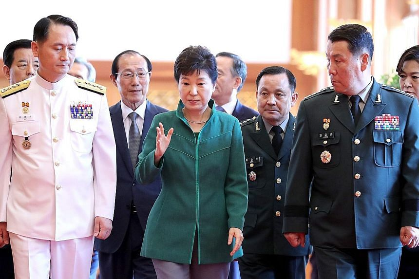 President Park with Vice- Admiral Um Hyun Seong (far left), the new Navy Chief of Staff, and Lieutenant General Lim Ho Young, the new deputy commander of the South Korea-US Combined Forces Command, after attending a ceremony in Seoul yesterday to mar