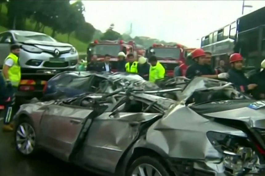 A screenshot from an online news report shows the aftermath of the incident, in which the bus swerved and drove over three cars.