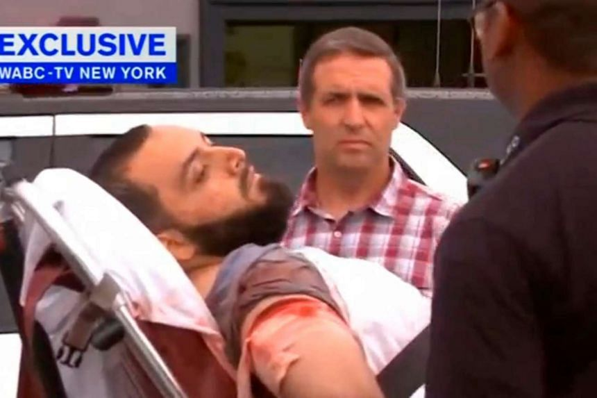 A man thought to be bombing suspect Ahmad Khan Rahami is loaded into an ambulance after a shoot-out with police on Sept 19, 2016.