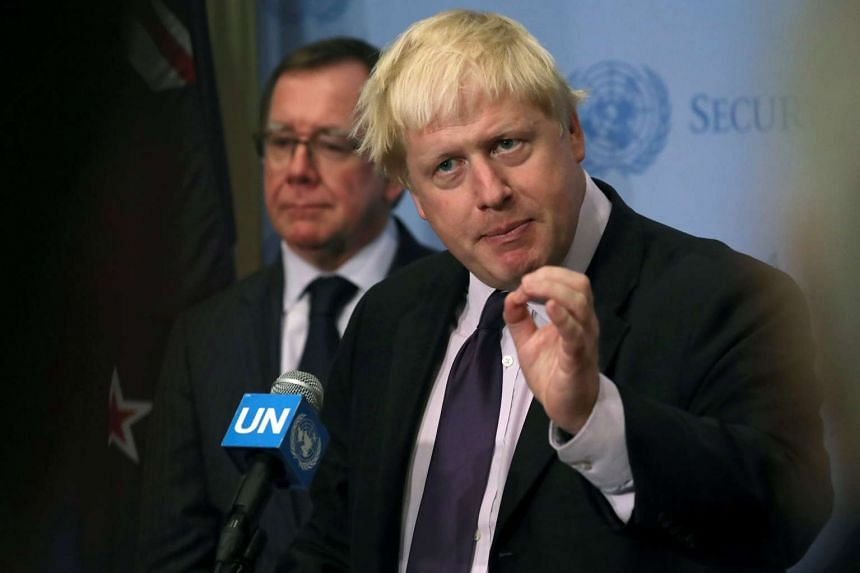 Britain's Foreign Secretary Boris Johnson (right) attends a press briefing at the United Nations in New York on Sept 22, 2016.