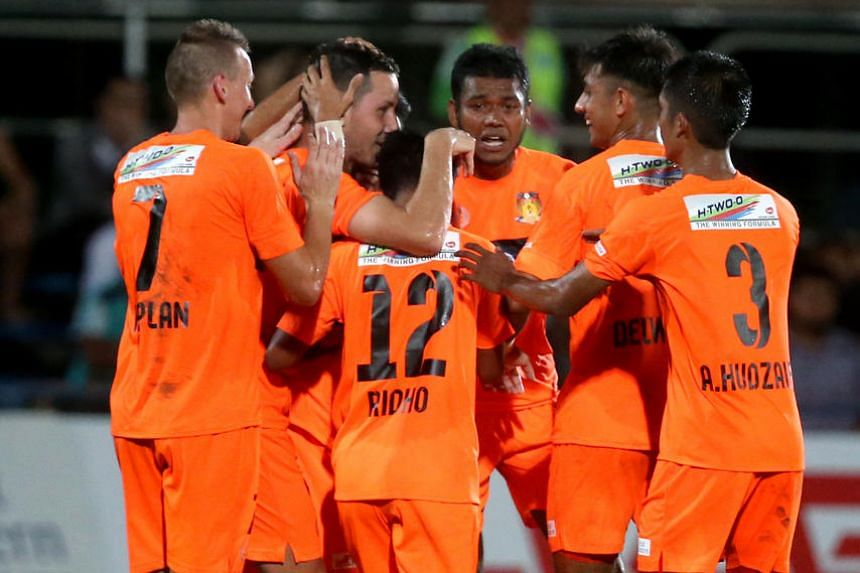 Hougang United's Croatian midfielder Stipe Plazibat (second from left) is the toast of his team-mates, after opening their account in the 34th minute of their S-League opener against Home United.