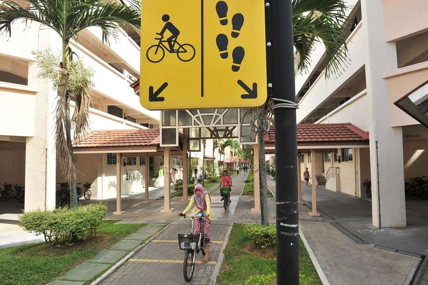 People cycling on a bike path between Tampines Street 83 and 82.