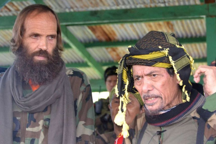 Norwegian Kjartan Sekkingstad (left) stands next to Moro National Liberation Front leader Nur Misuari after he was freed from the Al-Qaeda-linked Abu Sayyaf Islamist militant group in the southern Philippines on Sept 18, 2016.
