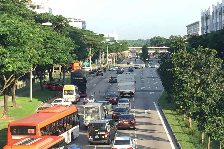 A red Honda mowed through the road divider on Eunos Link on Friday (Sept 23) morning, cutting through four lanes to crash into a bus full of commuters.