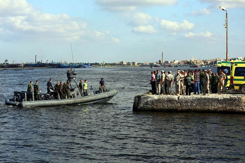 A military Rigid-hilled inflatable boat carrying recovered bodies placed in body bags arrive to the shore of the port city of Rosetta, Egypt on Sept 22, 2016.