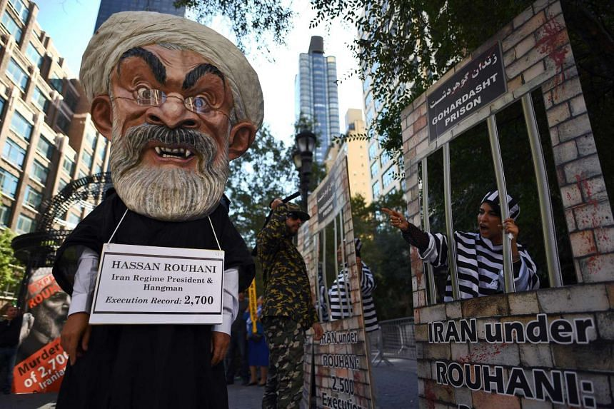 Demonstrators protest against Iran's President Hassan Rouhani outside the UN headquarters in New York on Sept 22, 2016.