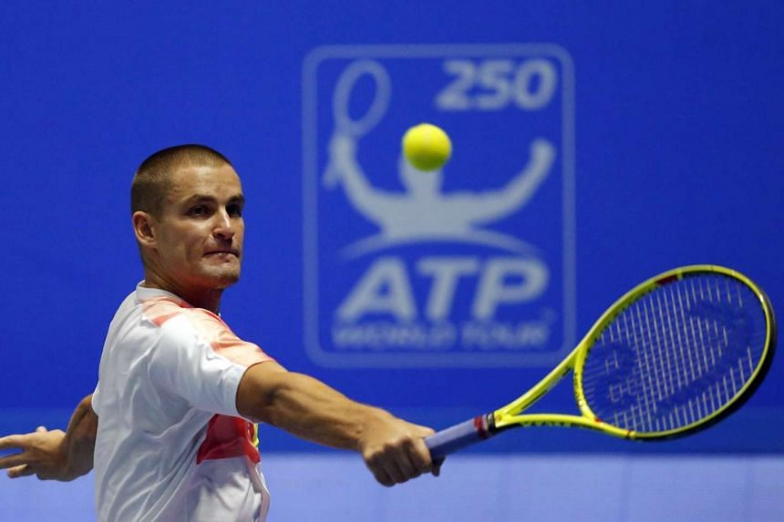 Mikhail Youzhny of Russia in action against Milos Raonic of Canada.