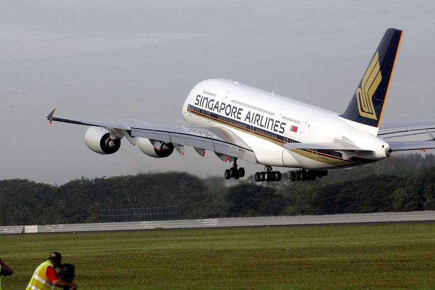 Singapore Airlines' first Airbus A380 superjumbo taking off for its first commercial flight on Oct 25, 2007.