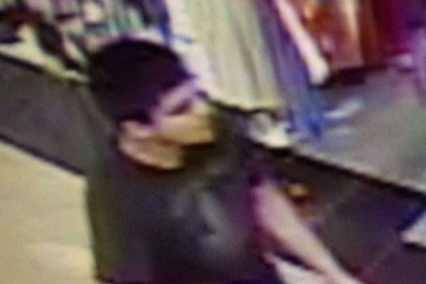 A handout photograph made avaliable by Washington State Patrol showing a man believed to be the shooter, armed with a rifle, who Washington State Patrol officers said is wanted in connection in the fatal shooting at the Cascade Mall in Burlington, Wa