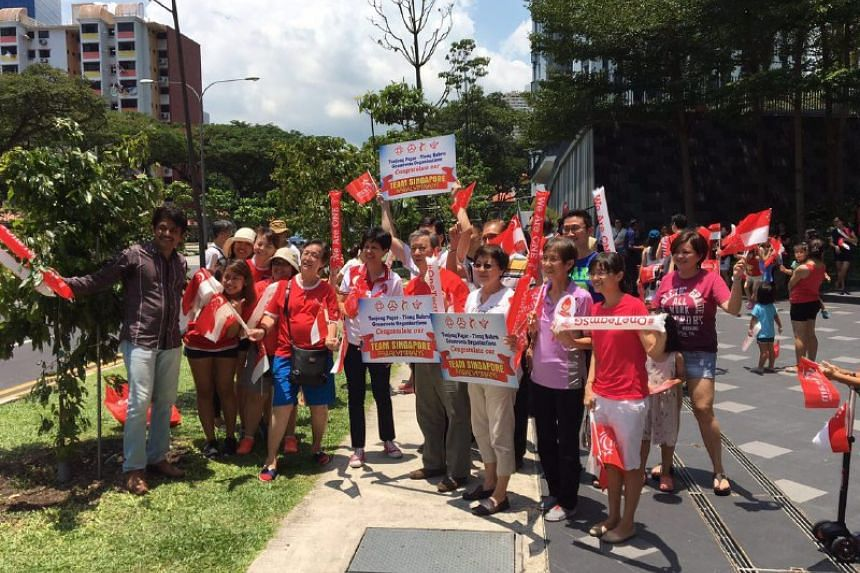 Ms Indranee Rajah and supporters waiting for the arrival of the Paralympians at Cantonment Road.