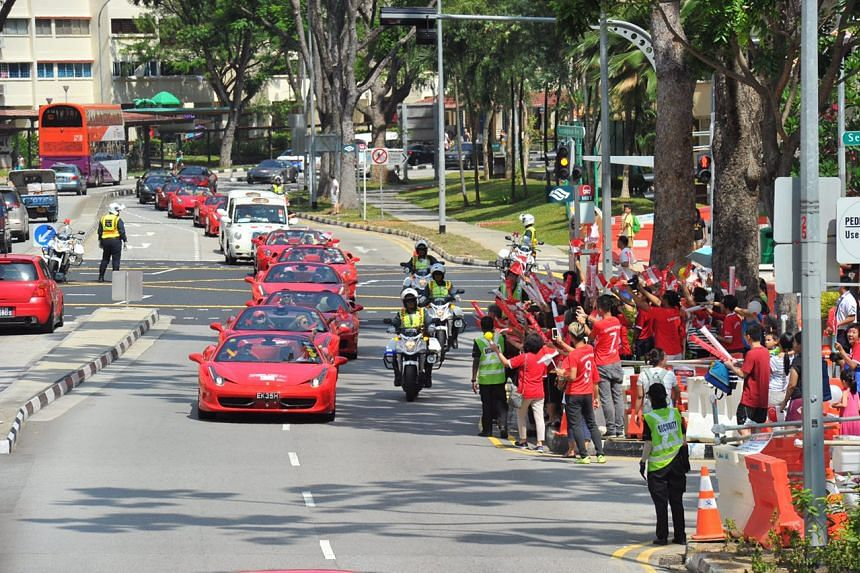 The gleaming Ferrari cars and London cabs making their way to the National Library.