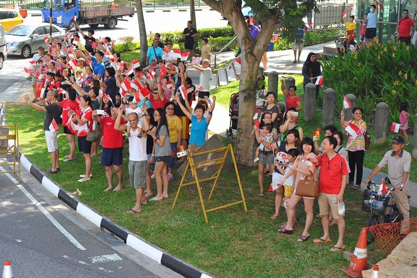 The crowd waving to the Paralympians during the parade.
