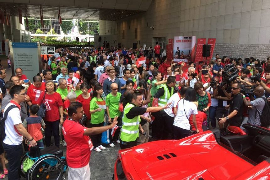 The crowd welcoming the Paralympians at the National Library.