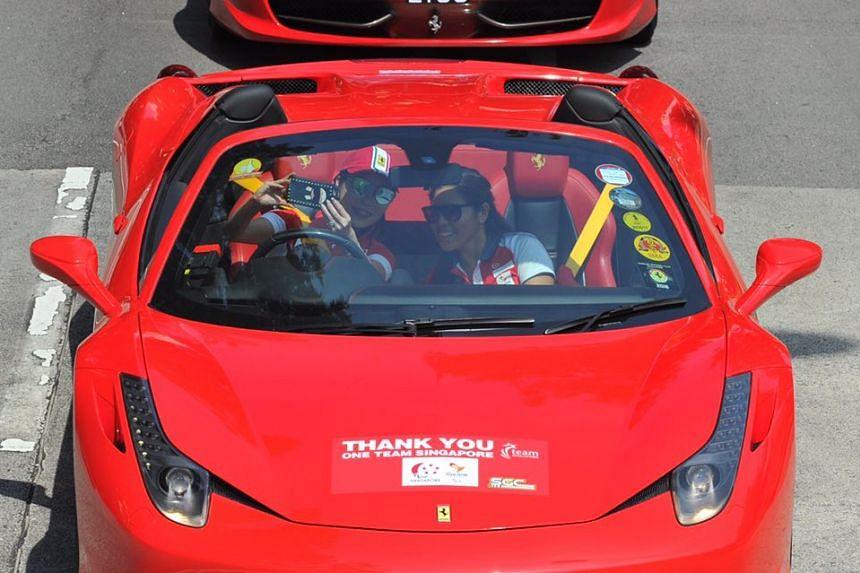 Paralympian Yip Pin Xiu posing for a photo in the Ferrari.