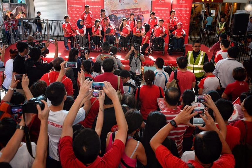 The Paralympians speaking on stage at Sengkang Sports Centre.
