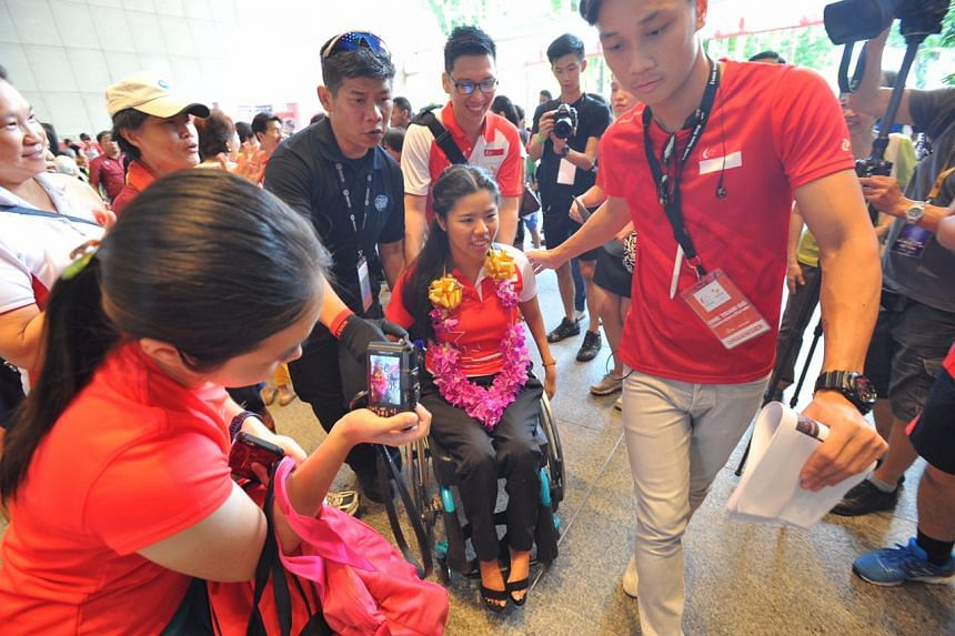 A fan takes a photo of three-time Paralympic champion Yip Pin Xiu.