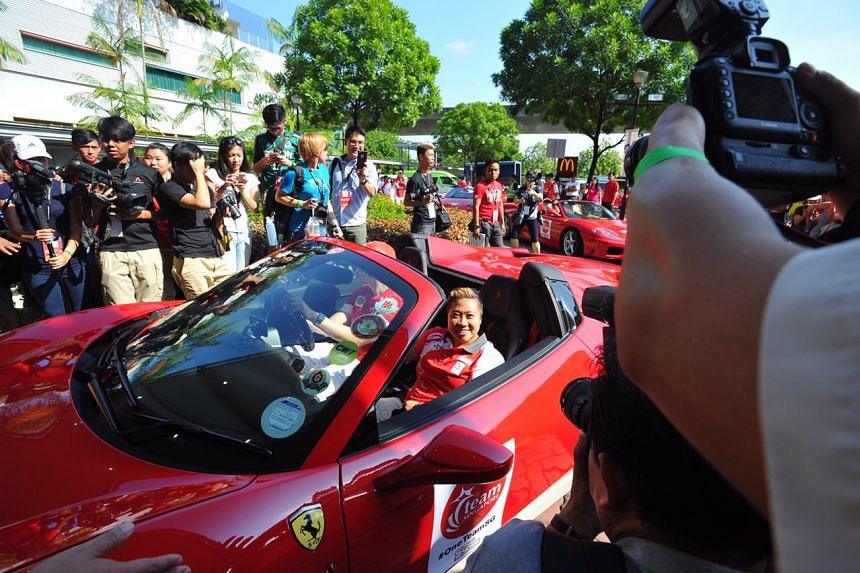 Paralympian Theresa Goh posing for a photo in the Ferrari.