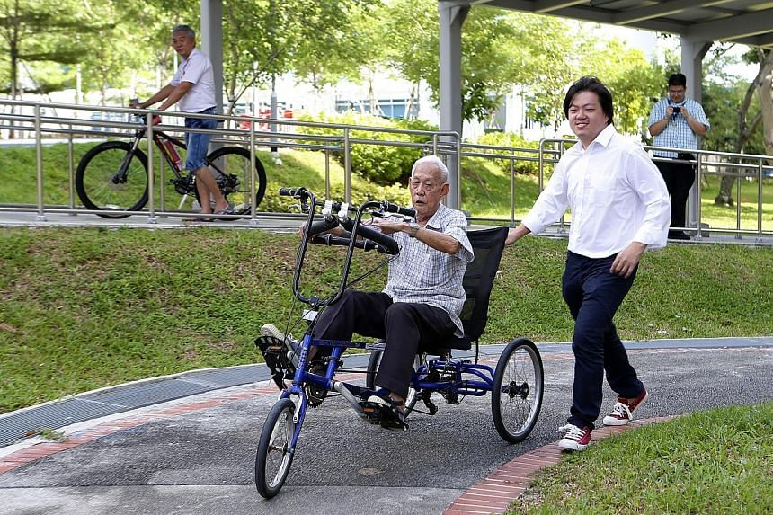 Businessman Axl Loon (above right), whose company is the marketing agent for the MonoMano Tricycle, with Mr Chua Keng Kok on the tricycle.