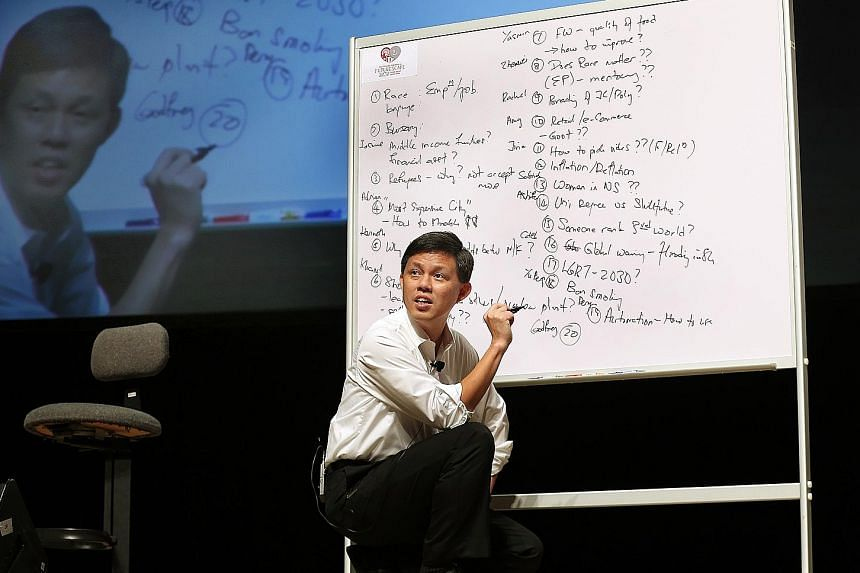 Mr Chan responding to questions put to him by polytechnic students at yesterday's dialogue.
