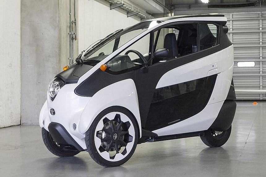 The Toyota i-Road has a completely enclosed cabin, with a pair of doors plus front and rear windscreens made of a resin-like material.