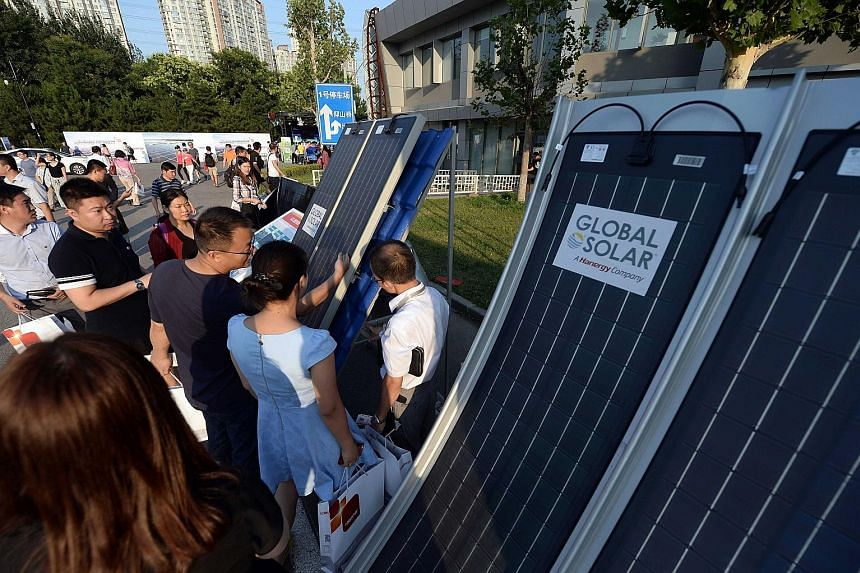 Solar panels on display at a recent clean energy event in Beijing. China has been the single largest developer of clean energy technology for eight years.