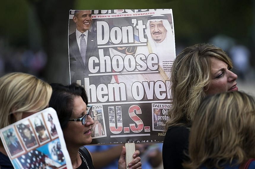 Protesters demonstrating outside the White House on Tuesday over the Justice Against Sponsors of Terrorism Act. The legislation would create a statutory mechanism allowing families of victims of the Sept 11, 2001 attacks to sue Saudi Arabia in United