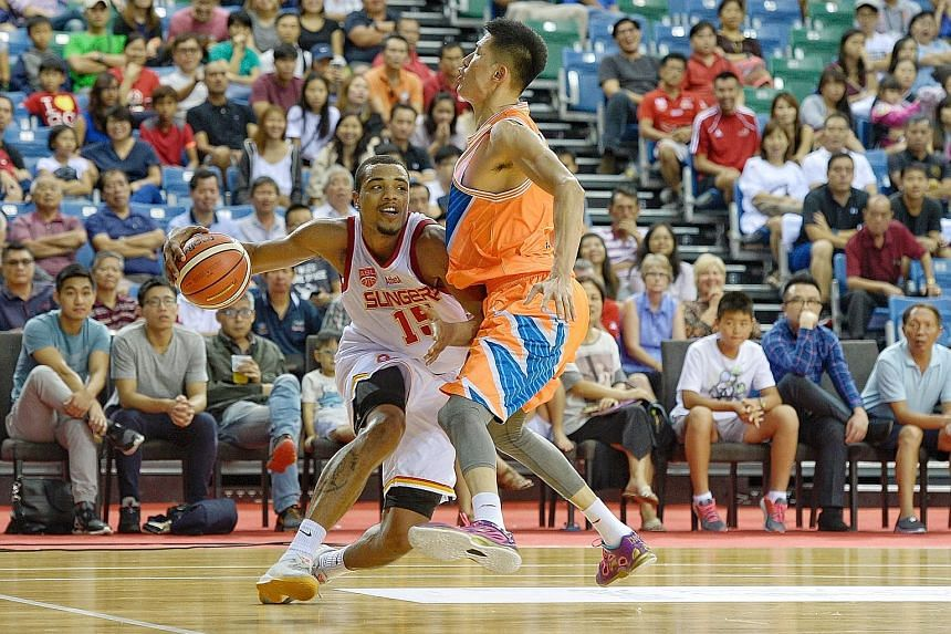The Singapore Slingers' American import Xavier Alexander driving to the basket against Cai Liang of the Shanghai Sharks in their Merlion Cup Group A game last night. The Sharks, owned by former National Basketball Association star Yao Ming, overpower