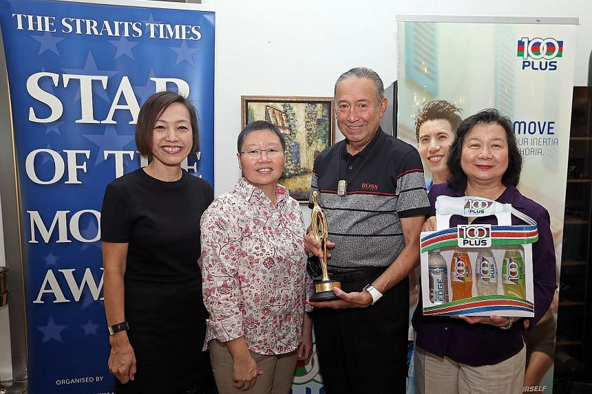 Joseph Schooling's parents Colin and May receiving The Straits Times' Star of the Month award for August on their son's behalf on Thursday. The award was presented by Jennifer See, the general manager of F&N Foods Singapore (extreme left) and Lee Yul