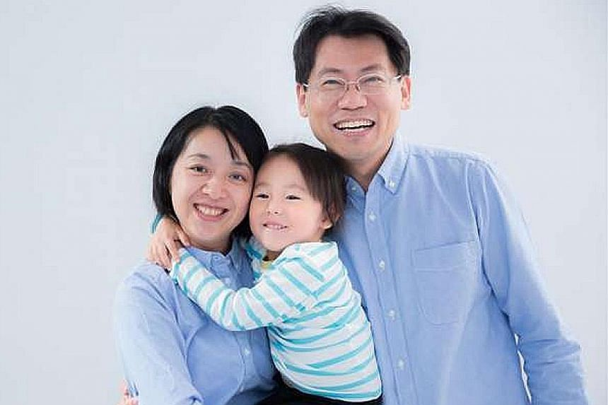 Ms Claire Wang with her husband and daughter, who was slashed multiple times and decapitated in March.