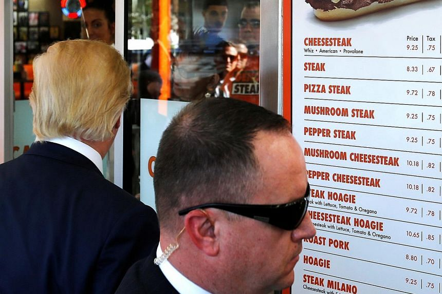A Secret Service agent keeping watch as Mr Trump made a stop at a restaurant in Philadelphia on Thursday.