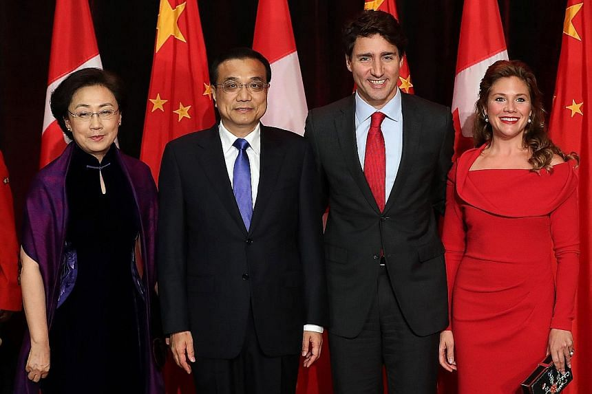 Chinese Premier Li Keqiang and Canadian Prime Minister Justin Trudeau with their wives before the state dinner in Quebec on Thursday. Mr Li's four-day visit, the first by a Chinese premier in 13 years, is a further step in moves to deepen ties betwee