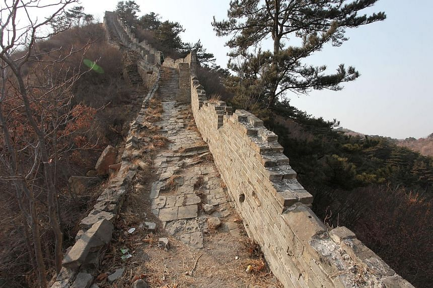 Above: An unrestored section of the Great Wall located in Suizhong County. Right: The paved-over section that provoked the ire of preservationists and media commentators.