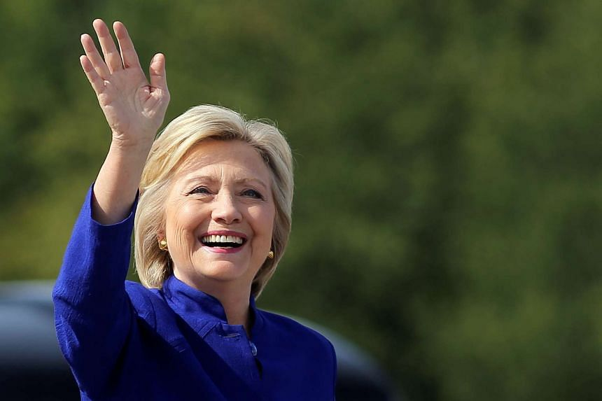 US Democratic presidential candidate Hillary Clinton waving as she boards her campaign plane at the Westchester County airport in White Plains, New York, US, on Sept 21, 2016.