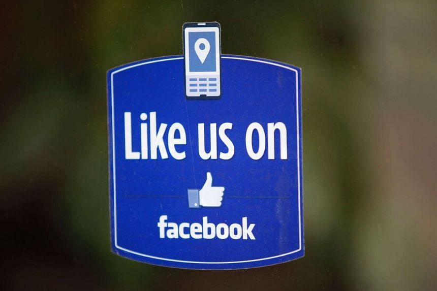 A Facebook like button logo displayed on a window of a store in Palo Alto, California.