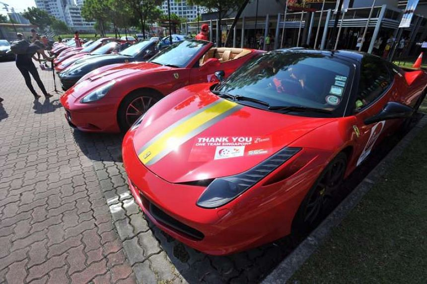 Ferraris lining up in front of the sports centre for the Paralympians Parade.