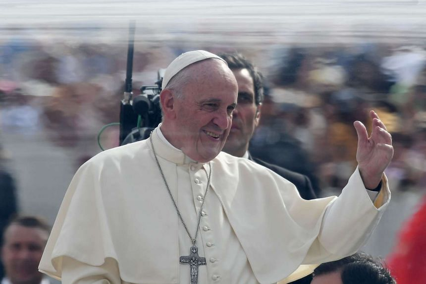 Pope Francis waves upon his arrival at Saint Peter's Square on Sept 21, 2016.