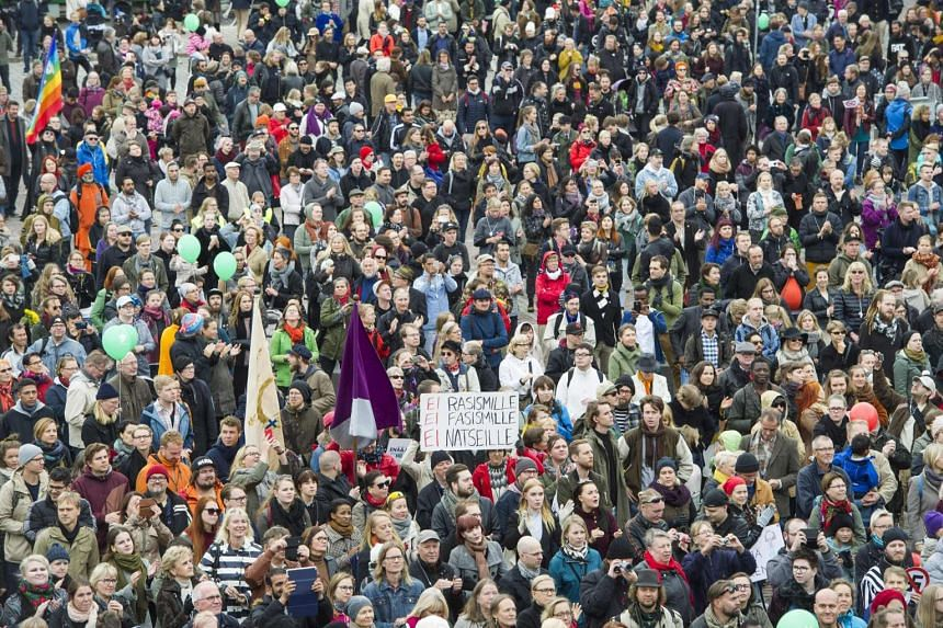 People demonstrate against racism and fascism in Helsinki, Finland on Sept 24, 2016.