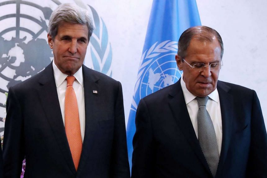 Kerry and Lavrov pose for a photo at  the United Nations in Manhattan, New York, on Sept 23, 2016.