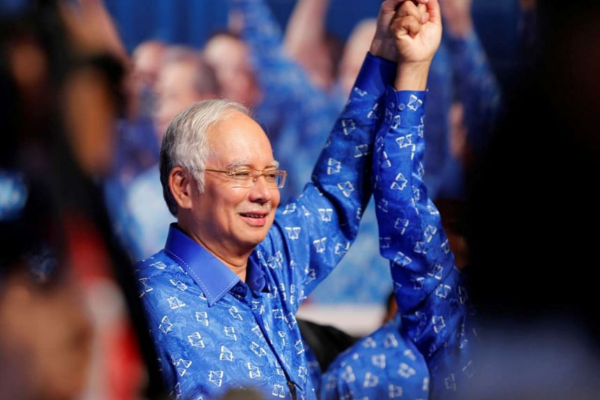 Malaysia's Prime Minister Najib Razak celebrating with his other party leaders after winning the elections at his party headquarters in Kuala Lumpur on May 6, 2013.
