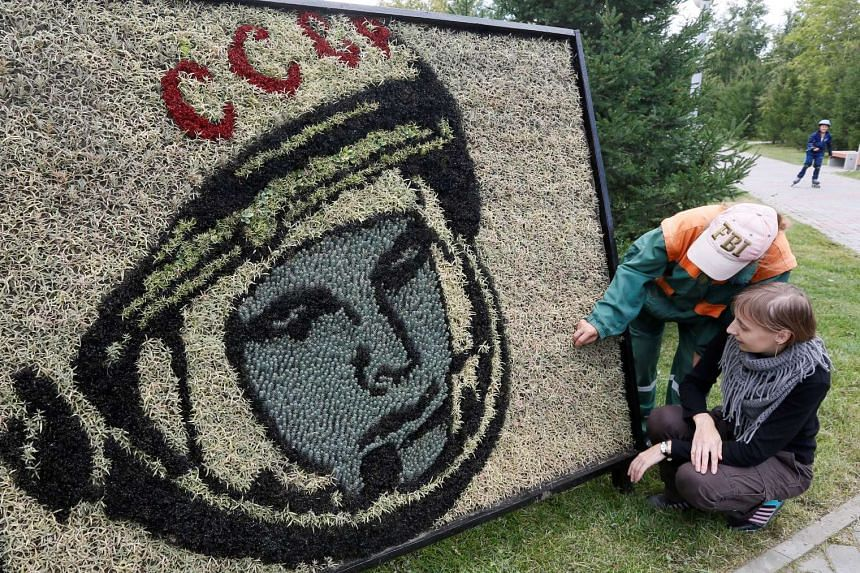 Employees prepare a portrait made from plants of the first man in space Yuri Gagarin in Krasnoyarsk, Russia, on Aug 30, 2016.