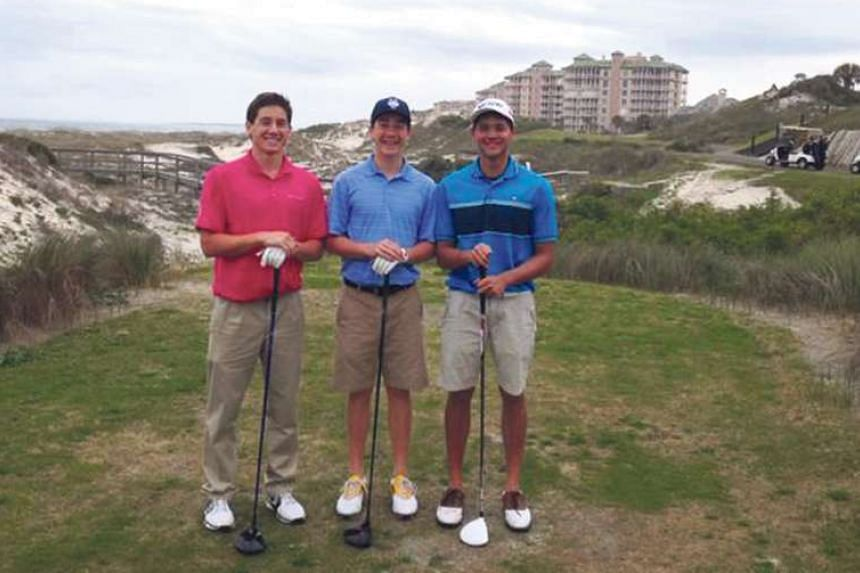 Joseph (right) with his US college buddies, brothers Walker (far left) and Grant Hill, in Jacksonville in the US.