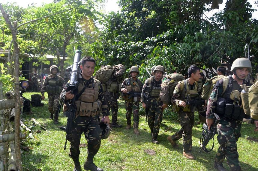 Philippine soldiers arrive at a camp after an armed encounter with members of militant group Abu Sayyaf at the village of Bongkaong on Aug 26, 2016.